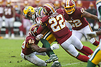 Landover, MD - September 23, 2018: Washington Redskins defensive back Deshazor Everett (22) tackles Green Bay Packers wide receiver Randall Cobb (18) during the  game between Green Bay Packers and Washington Redskins at FedEx Field in Landover, MD.   (Photo by Elliott Brown/Media Images International)