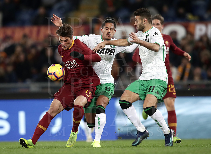 Football, Serie A: AS Roma - US Sassuolo, Olympic stadium, Rome, December 26, 2018. <br /> Roma's Patrik Schick (l) in action with Sassuolo's Mauricio Lemos (c) and Gianmarco Ferrari (r) during the Italian Serie A football match between Roma and Sassuolo at Rome's Olympic stadium, on December 26, 2018.<br /> UPDATE IMAGES PRESS/Isabella Bonotto