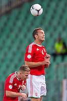 Hungary's Balazs Dzsudzsak (L) and Hungary's Roland Juhasz (R) jumps for a header during a World Cup 2014 qualifying soccer match Hungary playing against Netherlands in Budapest, Hungary on September 11, 2012. ATTILA VOLGYI