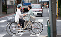 June 5, 2012 - Tokyo, Japan - A Japanese woman is seen riding a bicycle in downtown Tokyo. (Photo by Yumeto Yamazaki/AFLO)