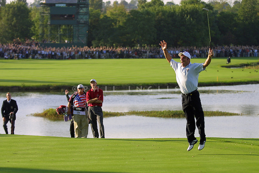 Paul McGinley of the European team celebrates his win on the 18th green against Jim Furyk of the US team in the singles matches for Europe to win the Ryder Cup at the Belfry on 29th September 2006 in Sutton Coldfield, England....