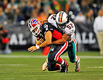 7 December 2008: Buffalo Bills' quarterback J.P. Losman is tackled by Miami Dolphins linebacker Channing Crowder after gaining a first down in the 4th quarter during the first regular season NFL game ever played in Canada. The Dolphins defeated the Bills 16-3 at the Rogers Centre in Toronto, Ontario. ..Mandatory Photo Credit: Ed Wolfstein Photo