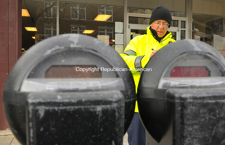 TORRINGTON, CT-02 February 2010-020210S02-- Torrington's new parking enforcement officer Edward Andreski, writes out a parking ticket for an vehicle at an expired meter on Main Street in Torrington on Tuesday. <br /> Jim Shannon Republican-American