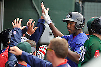 First baseman Josh Ockimey (18) of the Greenville Drive is congratulated after scoring in a game against the Asheville Tourists on Sunday, April 10, 2016, at Fluor Field at the West End in Greenville, South Carolina. Greenville won 7-4. (Tom Priddy/Four Seam Images)