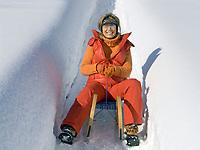 Deutschland, Frau auf einem Schlitten | Germany, woman on a sledge
