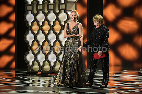 26 February 2017 - Hollywood, California - Charlize Theron and Shirley MacLaine. 89th Annual Academy Awards presented by the Academy of Motion Picture Arts and Sciences held at Hollywood & Highland Center. Photo Credit: AMPAS/AdMedia