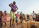 A woman pumps water from a well in Lugi, a village in the Nuba Mountains of Sudan. The area is controlled by the Sudan People's Liberation Movement-North, and frequently attacked by the military of Sudan.