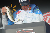 NWA Democrat-Gazette/FLIP PUTTHOFF <br /> Andy Morgan of Dayton, Tenn., digs fish out of his weigh-in bag Sunday April 17, 2016. Morgan finished sixth in the Walmart FLW Tour bass tournament at Beaver Lake.