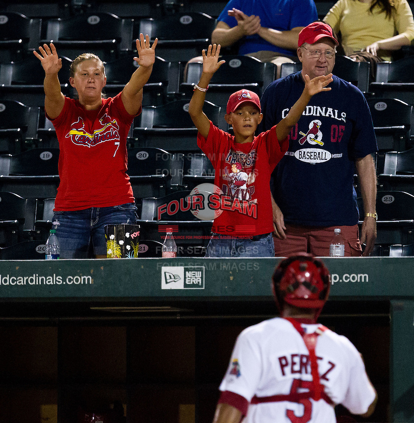 Young fans raise their hands for a baseball during a game between the Arkansas Travelers and the Springfield Cardinals at Hammons Field on July 25, 2012 in Springfield, Missouri. (David Welker/Four Seam Images)