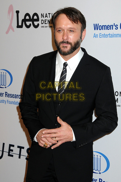 TIM McGRAW.EIF's Women's Cancer Research Fund Benefit held at the Beverly Wilshire Hotel, Beverly Hills, California, USA..January 27th, 2010.half length suit hands black white beard facial hair .CAP/ADM/BP.©Byron Purvis/AdMedia/Capital Pictures.