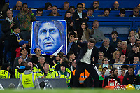 A fan holds up a large picture of Chelsea manager Antonio Conte   <br /> <br /> <br /> Photographer Craig Mercer/CameraSport<br /> <br /> The Premier League - Chelsea v Watford - Monday 15th May 2017 - Stamford Bridge - London<br /> <br /> World Copyright &copy; 2017 CameraSport. All rights reserved. 43 Linden Ave. Countesthorpe. Leicester. England. LE8 5PG - Tel: +44 (0) 116 277 4147 - admin@camerasport.com - www.camerasport.com