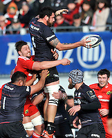 Hendon, England. Jim Hamilton of Saracens wins the line out during the European Rugby Champions Cup match between Saracens and Munster at Allianz Park stadium on January 17, 2015 in Hendon, England.