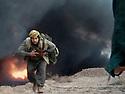 Iraq 2014, November 26, on the front near Kirkouk, peshmerga of Hama Haji Mahmoud Irak 2014  Le 26 novembre, sur le front pres de Kirkouk, un peshmerga de Hama Haji Mahmoud courant sous les bombardements