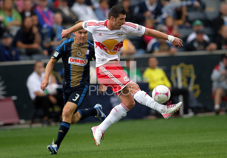 CHESTER, PA - OCTOBER 27, 2012:  Chris Albright (3) of the Philadelphia Union watches  Kenny Cooper (33) of the New York Red Bulls boot the ball up field during an MLS match at PPL Park in Chester, PA. on October 27. Red Bulls won 3-0.