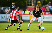 Lincoln City's Elliott Whitehouse vies for possession with  Exeter City's Jordan Tillson<br /> <br /> Photographer Andrew Vaughan/CameraSport<br /> <br /> The EFL Sky Bet League Two Play Off Second Leg - Exeter City v Lincoln City - Thursday 17th May 2018 - St James Park - Exeter<br /> <br /> World Copyright &copy; 2018 CameraSport. All rights reserved. 43 Linden Ave. Countesthorpe. Leicester. England. LE8 5PG - Tel: +44 (0) 116 277 4147 - admin@camerasport.com - www.camerasport.com