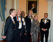 John Paul Jones, Jimmy Page, Buddy Guy, Robert Plant, Natalia Makarova, and Dustin Hoffman, six of the seven recipients of the 2012 Kennedy Center Honors, wait to pose for a photo following a dinner hosted by United States Secretary of State Hillary Rodham Clinton at the U.S. Department of State in Washington, D.C. on Saturday, December 1, 2012.  The 2012 honorees are Buddy Guy, actor Dustin Hoffman, late-night host David Letterman, dancer Natalia Makarova, and the British rock band Led Zeppelin (Robert Plant, Jimmy Page, and John Paul Jones)..Credit: Ron Sachs / CNP