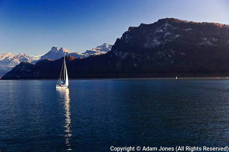 Sailboat on Lake Lucerne and autumn colors, Lucerne, Switzerland