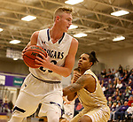 SIOUX FALLS, SD - NOVEMBER 25: Drew Guebert #23 from the University of Sioux Falls looks to make a move against 	KJ Davis #14 from Southwest Minnesota State University during their game Saturday night at the Stewart Center in Sioux Falls. (Photo by Dave Eggen/Inertia)