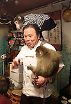 """October 22, 2016, Utsunomiya, Japan -  The pub master Kaoru Otsuka smiles with Japanese macaques Fuku (meaning happiness) and Yume (meaning dream) at an izakaya, Japanese pub """"Kayabuki"""" in Utsunomiya, 100km north of Tokyo on Saturday, October 22, 2016. The pub master Kaoru Otsuka trains Japanese macaques to help him and show their entertainment skills to attract customers including lots of foreign tourists.   (Photo by Yoshio Tsunoda/AFLO) LWX -ytd-"""