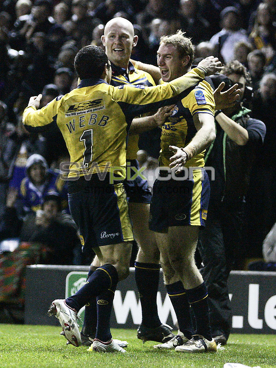 PICTURE BY VAUGHN RIDLEY/SWPIX.COM - Rugby League - Carnegie World Club Challenge - Leeds Rhinos v Melbourne Storm - Elland Road, Leeds, England - 29/02/08...Copyright - Simon Wilkinson - 07811267706..Leeds Scott Donald celebrates with Brent Webb and Keith Senior.