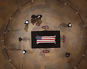 President Trump salutes as he and First Lady Melania Trump pay their respects as Former President George H. W. Bush lies in state in the U.S. Capitol Rotunda Monday, Dec. 3, 2018, in Washington. (Pool photo by Morry Gash via AP)