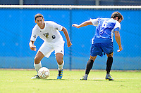 2 October 2011:  FIU defender Christian Melean (6) steals the ball from Kentucky midfielder Matt Lodge (6) in the first half as the FIU Golden Panthers defeated the University of Kentucky Wildcats, 1-0 in overtime, at University Park Stadium in Miami, Florida.