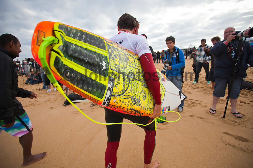 Julian Wilson (AUS).  CULS NUS BEACH, Hossegor/France (Monday, September 27, 2010) -The pumping barrels of yesterday gave way to inconsistent two-to-three foot (1 metre) waves this morning, prompting event organizers at the Quiksilver Pro France to call competition off after completing the opening three heats of Round 2.. .The seventh stop on the 2010 ASP World Tour, the Quiksilver Pro France was forced to halt competition early today, but the world's best surfers still provided fireworks amidst the challenging conditions.. .Julian Wilson (AUS), 21, wildcard into the Quiksilver Pro France, caused a major upset this morning, defeating current ASP World No. 6, Bede Durbidge (AUS), 27, with a strong backhand wave at the end of the heat.Kelly Slater (USA), 38, former nine-time ASP World Champion and current ASP World No. 1, survived a wave-starved Round 2 bout today against wildcard Maxime Huscenot (FRA), 18, in the opening heat of the day..Gabe Kling (USA), 30, wildcard for the back half of the 2010 ASP World Tour season, scored the day's second and final major upset, ousting current ASP World No. 7, Adriano de Souza (BRA), 23, from Quiksilver Pro France competition.. Photo: joliphotos.com