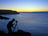 Silhouette of a photographer composing a picture.