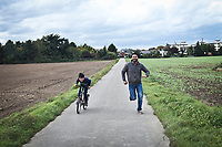 GERMANY, Pulheim: Abu Ali and Youssef running and biking in the neighbourhood of Pulheim.
