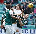 No joy for Jon Daly as he is eased off the ball