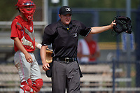 Umpire Alex Lawrie signals fair ball during a Gulf Coast League game between the GCL Phillies East and GCL Yankees East on July 31, 2019 at Yankees Minor League Complex in Tampa, Florida.  (Mike Janes/Four Seam Images)