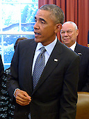 United States President Barack Obama, with America's Promise Alliance Founding Chairman and former US Secretary of State General Colin Powell (R), responds to a question from the news media after signing the America's Promise Summit Declaration during a ceremony in the Oval Office of the White House in Washington, DC, USA 22 September 2014. President Obama will be the seventh consecutive president to sign the declaration, which calls on Americans to help the youth of America reach their full potential.<br /> Credit: Shawn Thew / Pool via CNP