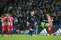 Goalkeeper Kasper Schmeichel of Leicester City reaction at full time as Atletico Madrid players celebrate during the UEFA Champions League QF 2nd Leg match between Leicester City and Atletico Madrid at the King Power Stadium, Leicester, England on 18 April 2017. Photo by Andy Rowland.