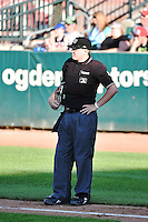 Home plate umpire Jordan Johnson during the game between the Great Falls Voyagers and the Ogden Raptors on July 16, 2014 at Lindquist Field in Ogden, Utah. (Stephen Smith/Four Seam Images)