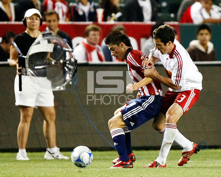 Chivas USA midfielder, Jorge Flores(19) shields the ball away from NY Red Bulls defender, Hunter Freeman(3). Chivas USA  took on the NY Red Bulls on June 28, 2008 at the Home Depot Center in Carson, CA. The game ended in a 1-1 tie.
