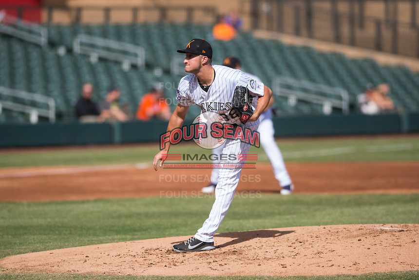 Salt River Rafters starting pitcher Ryan Castellani (38), of the Colorado Rockies organization, follows through on his delivery during an Arizona Fall League game against the Glendale Desert Dogs at Salt River Fields at Talking Stick on October 31, 2018 in Scottsdale, Arizona. Glendale defeated Salt River 12-6 in extra innings. (Zachary Lucy/Four Seam Images)