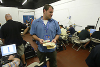 MIAMI, FL - Sports Illustrated picture editor Nate Gordon works in the photo work room before Game 5 of the 2003 World Series between the Florida Marlins and the New York Yankees at Yankee Stadium in Miami, Florida on October 23, 2003. Photo by Brad Mangin