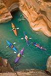 Kayaker, Havasu Creek, Grand Canyon National Park, Mile 157, Colorado River, Arizona, Southwest, USA, Standish Marks, instructing the hand roll, released,.