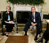 United States Secretary of Education Margaret Spellings (L) and U.S. President George W. Bush poses for photographers in the Oval Office at the White House September 6, 2005 in Washington, DC. President Bush spoke about efforts to assist students and school districts in the Gulf Coast states who were displaced by Hurricane Katrina.  <br /> Credit: Chip Somodevilla / Pool via CNP