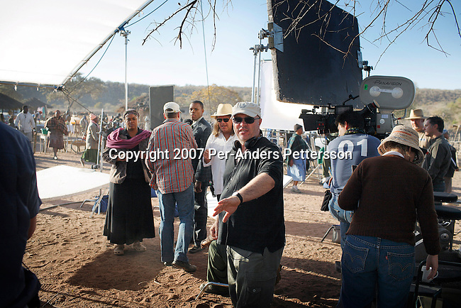 GABORONE, BOTSWANA - AUGUST 18: Anthony Minghella (c), the Oscar-winning director, instructs crew and actors before a funeral scene on the set of The No 1 Ladies Detective Agency on August 18, 2007 in Gaborone, Botswana. The film is based on Alexander McCall Smith?s best-selling series. Mr. Minghella and his crew filmed for months around Botswana and the Government of Botswana has invested $US5 Million in the project. (Photo by Per-Anders Pettersson/Getty Images)...