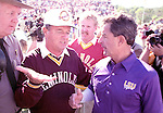 Florida State's Bobby Bowden talks with LSU head coach Mike Archer after the Seminoles defeated LSU 42-3 giving Bowden his 200th victory in Tallahassee Octobere 27, 1990. (Mark Wallheiser/TallahasseeStock.com)