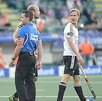 The Hague, Netherlands, June 06: Thilo Stralkowski #26 of Germany in contact with the umpire during the field hockey group match (Men - Group B) between Germany and The Netherlands on June 6, 2014 during the World Cup 2014 at Kyocera Stadium in The Hague, Netherlands. Final score 0-1 (0-1) (Photo by Dirk Markgraf / www.265-images.com) *** Local caption *** Thilo Stralkowski #26 of Germany, Linus Butt #3 of Germany