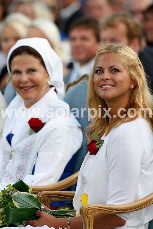 **ALL ROUND PICTURES FROM SOLARPIX.COM**.**SYNDICATION RIGHTS FOR UK AND SPAIN ONLY**.Crown Princess Victoria of Sweden celebrates her 32nd birthday with fiance Daniel Westling and parents Queen Silvia and King Carl Gustaf of Sweden at Solliden Palace on the island of Oeland, southern Sweden. 14 July 2009..This pic: Queen Silvia and Princess Madeleine..JOB REF: 9494 CPR (Kongsted) DATE: 14_07_2009.**MUST CREDIT SOLARPIX.COM OR DOUBLE FEE WILL BE CHARGED**.**ONLINE USAGE FEE GBP 50.00 PER PICTURE - NOTIFICATION OF USAGE TO PHOTO @ SOLARPIX.COM**.**CALL SOLARPIX : +34 952 811 768 or LOW RATE FROM UK 0844 617 7637**