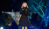Actress Reese Witherspoon speaks from the stage during the National Christmas tree lighting ceremony on the Ellipse south of the White House December 3, 2015 in Washington, DC. The lighting of the tree is an annual tradition attended by the President and the first family.<br /> Credit: Olivier Douliery / Pool via CNP