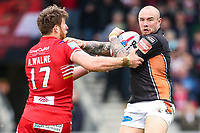 Picture by Alex Whitehead/SWpix.com - 19/03/2017 - Rugby League - Betfred Super League - Salford Red Devils v Castleford Tigers - AJ Bell Stadium, Salford, England - Castleford's Nathan Massey is tackled by Salford's Adam Walne.