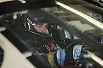 Veteran driver Joe Nemecheck presses the start button prior to heading out on the drack during NASCAR Nextel Cup testing at Daytona International Speedway in Daytona Beach, Fla., Wednesday, January 18, 2006.(AP Photo/Brian Myrick)