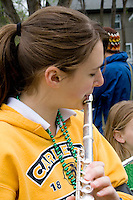 Flutist age 17 playing in parade band. MayDay Parade and Festival. Minneapolis Minnesota USA