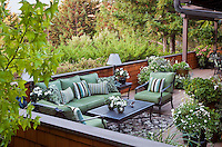 Balcony seating area in small space urban townhome patio garden