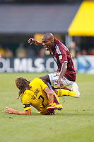 21 AUGUST 2010:  Colorado Rapids forward Omar Cummings (14) is fouled by Frankie Hejduk of the Columbus Crew(2) during MLS soccer game between Colorado Rapids vs Columbus Crew at Crew Stadium in Columbus, Ohio on August 21, 2010.