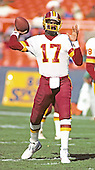 Washington Redskins quarterback Doug Williams (17) participates in warm-up drills prior to the game against the Detroit Lions at RFK Stadium in Washington, DC on November 15, 1987.  The Redskins won the game 20 - 13.<br />